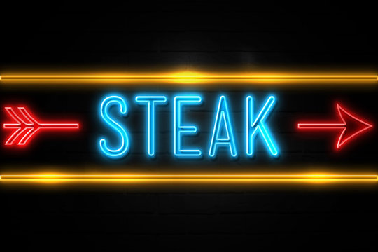 Steak  - fluorescent Neon Sign on brickwall Front view