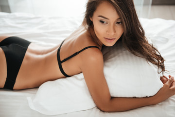 Portrait of a young beautiful asian woman in sexy lingerie