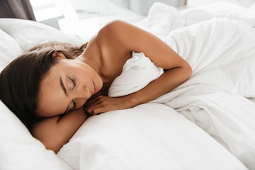Close up portrait of a young attractive asian woman sleeping