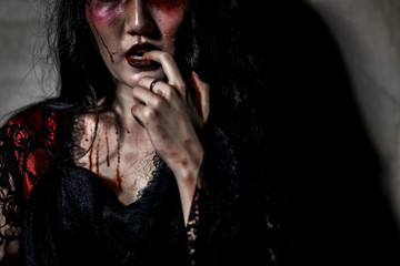 Zombie women death or witch the ghost drain hand blood skin is screaming darkness and nightmare, horror of scary fear on hell is monster in halloween festival concept,copy space the right.