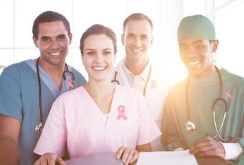 Composite image of portrait of a successful medical team at work