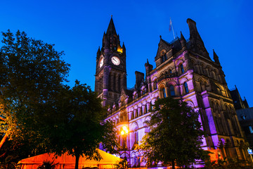 Illuminated Town Hall in Manchester, UK at night