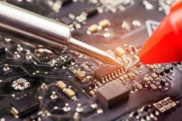 Repair of computer board soldering.selective focus.