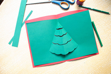 Process of making greeting card for christmas and new year with paper, scissors and pen.Merry xmas preparation.