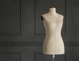 Vintage tailor's mannequin in elegant room with copy space