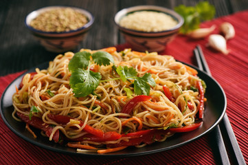 Asian salad with rice noodles and vegetables, korean style cuisine.