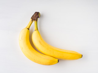 Two bananas on white background. Minimal flat lay
