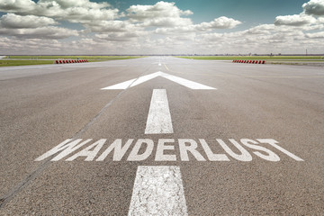 Airport runway arrow wanderlust