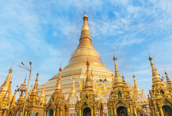Shwedagon big golden pagoda most sacred Buddhist pagoda in rangoon, Myanmar(Burma)  on blue sky background