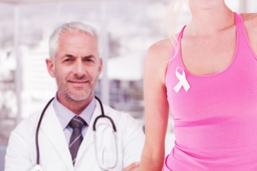 Composite image of mid section of woman wearing breast cancer
