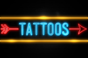 Tattoos  - fluorescent Neon Sign on brickwall Front view