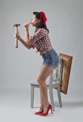 Girl with hammer .