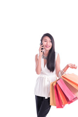 Cheerful shopping woman of Asian holding bags. Shopping smart business woman happy smiling holding colorful shopping bags with smart phone isolated on white . Fresh young Asian female model