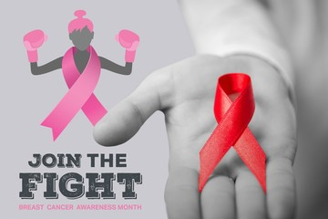 Composite image of midsection of person holding aids awareness