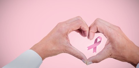 Composite image of breast cancer awareness ribbon