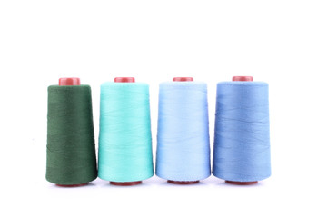 Colorful Sewing threads isolated on white background