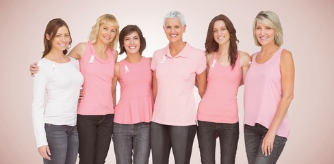 Composite image of portrait of smiling women supporting breast