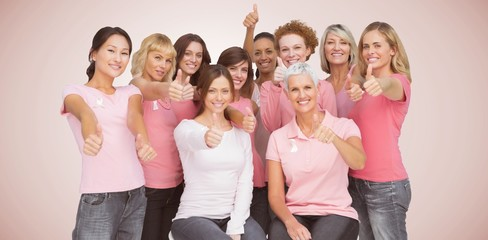 Composite image of portrait of female friends showing thums up