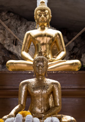 Gold Buddha statue in cave,selective focus