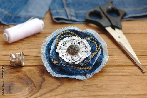 Blue flower brooch or hair accessory  Scissors, thread
