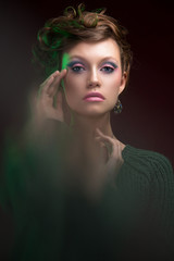 Beautiful, glamorous, girl, model in a photo studio with color filters. Portrait, beauty, style.