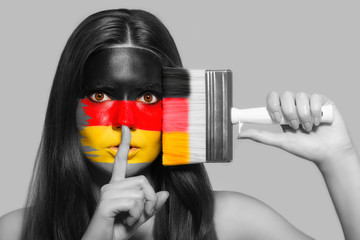 Female supporter in national colors of Germany