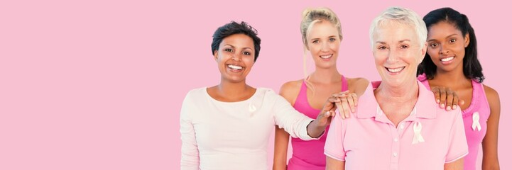 Composite image of portrait of women supporting breast cancer