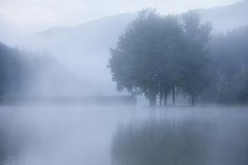 Lake at foggy morning misty weather
