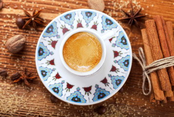 Turkish cup of coffee on spice background