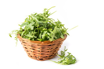 Rucola plant in a wicker bowl isolated