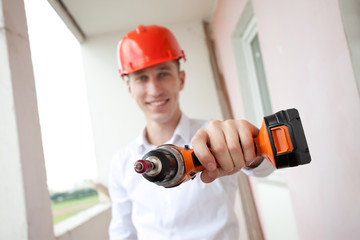smiling worker with drill