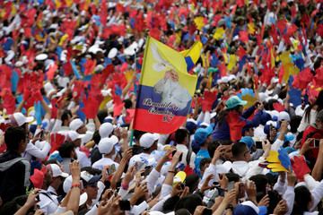 Faithful wait for the arrival of Pope Francis at Bolivar square in Bogota