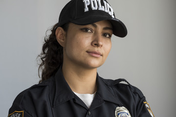 Portrait of a Hispanic female police officer