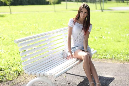 erotic girl with mini skirt on green grass