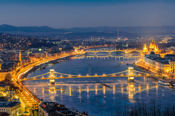Aerial view of Budapest at night. Hungarian landmarks: Chain Bridge, Parliament and Danube river in Budapest.
