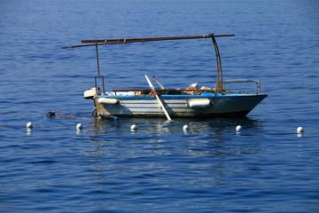 Small fishing boat and diver in Adriatic sea , Croatia