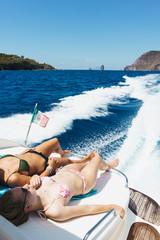Women relaxing on boat