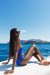 Stylish girl posing on yacht