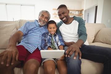 Multi-generation family using digital tablet in living room