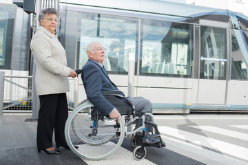 photo of a senior couple visiting the city