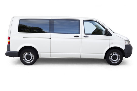 White van with windows on white background isolated with clipping path. White dropping shadow minivan on white