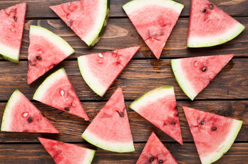 watermelon slices on dark wooden background top view
