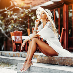 Beautiful woman in hat outdoor sensual portrait