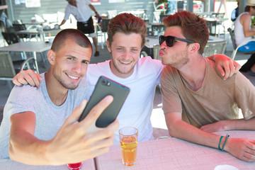 three friends sitting doing a selfie