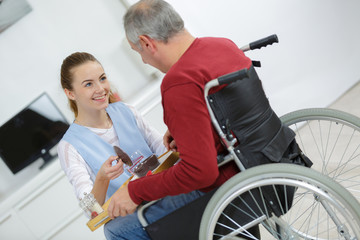disabled patient talking with a beautiful young nurse