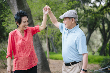 Senior couple dancing outdoors