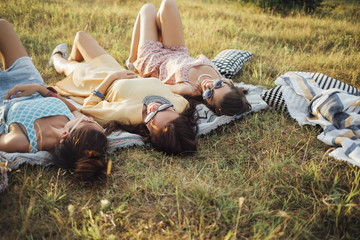 Three  Girls Lying on The Grass