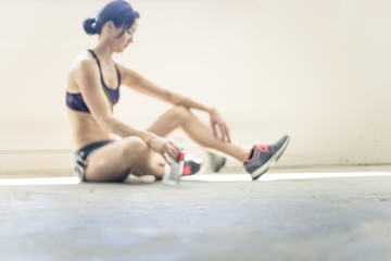 Woman Resting and Drinking After Working Out