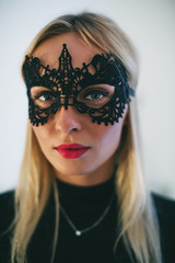 Portrait of a blonde woman wearing a halloween costume.