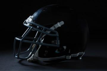 American football head gear on a black background